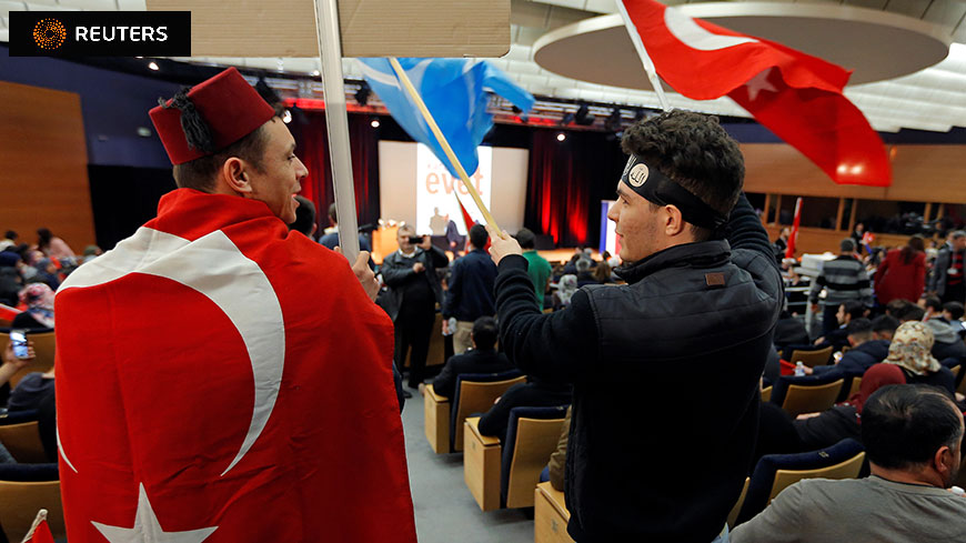 © 2017 REUTERS/Vincent Kessler www.reuters.com - Supporters wait before the start of Turkish Foreign Minister Çavuşoğlu's political rally on Turkey's upcoming referendum, in Metz (France)