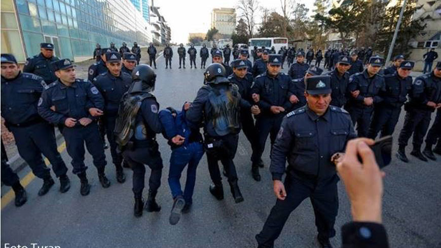 Police detain a protester and remove him from the scene of the protest on 16 February 2020 in front of the Central Election Committee. Photo: Turan.