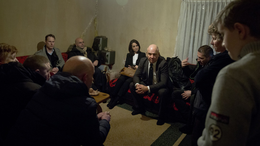 Commissioner for Human Rights Nils Muižnieks, talks to internally displaced ethnic Albanians living in Shipol in the outskirts of Mitrovica, Kosovo.