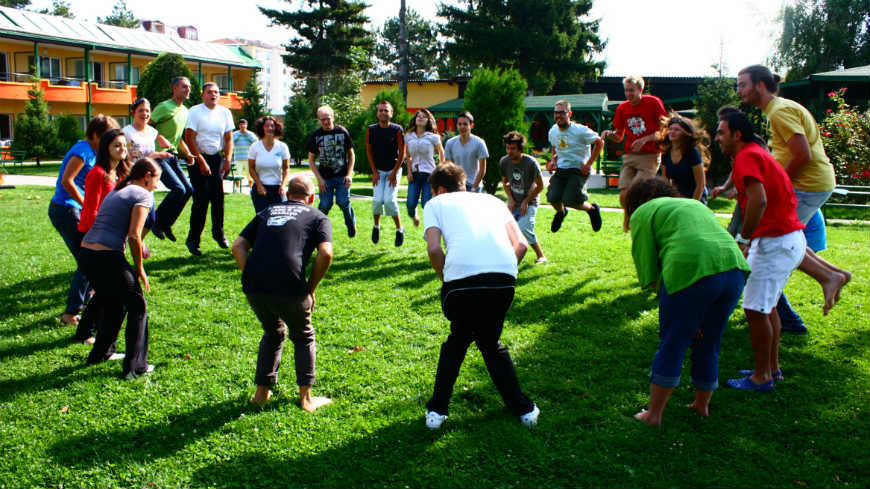 group of youth in circle jumping as part of an EYF supported activity