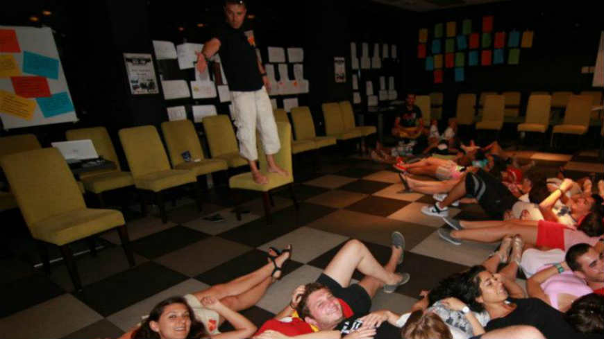 youth lying down on the floor as part of a youth activity