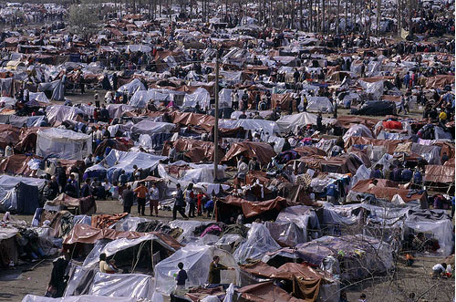 Photo: Refugees from Kosovo*. Copyright: UNHCR / H.J. Davies/ April 1999